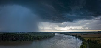 The river with a storm and a rain in the summer, Garonne river, Gironde stock images