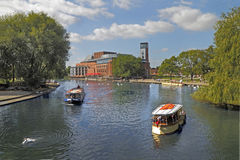 Stratford on Avon. The river at Stratford on Avon is a popular leisure facility, and on the far side can be seen the Royal Shakespeare Theatre Royalty Free Stock Photography