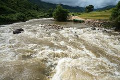 River stream in flood after several days of rain in north Vietnam.  royalty free stock photo