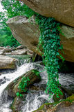 River stream flowing over rock formations in the mountains Royalty Free Stock Photos
