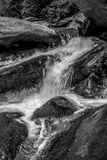 River stream flowing over rock formations in the mountains Stock Image