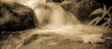 River stream flowing over rock formations in the mountains Stock Photos