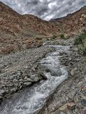 Mountains and Rivers of Ladakh. A river stream gushes between the mountains royalty free stock photo
