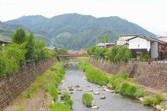 Panorama mountains river bridge village Hida Furukawa, Japan royalty free stock image