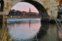 Bridge arch with river stream by sunset Royalty Free Stock Photos