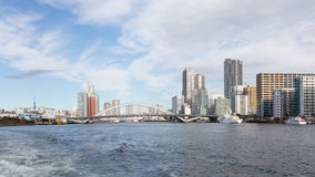 River Sumida. Tokyo - January 28, 2015: Urban cityscape, bridge over the river Sumida and ships sail January 28, 2015 in Tokyo, Japan Royalty Free Stock Images