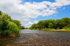 River summer landscape with blue sky and clouds Royalty Free Stock Image