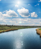 River and sun in clouds over it Royalty Free Stock Photography