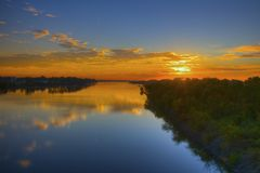 River Sunrise. Gloriouse river Sunrise with reflection in early morning calm water. Peaceful Stock Images
