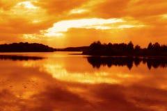 River at sunset. Golden sunset over lake in summer Stock Photo