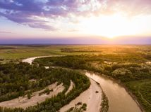 River at Sunset. Aerial shot of a river at sunset Stock Photos