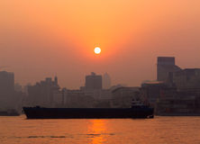 River at sunset. A busy day is past, the afterglow of sunset against the river vessel Royalty Free Stock Photography