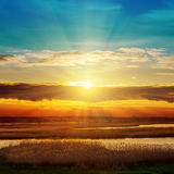 River and sunset in clouds Royalty Free Stock Photography