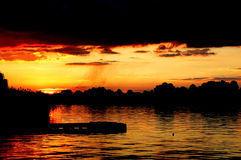 River Sunset Reflections. Early evening Sunset sihouette on the Vaal River, South Africa Stock Image
