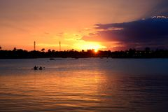 Sunset in river. River sunset in summer time royalty free stock photos