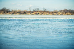 River surface with small ripples in the early spring. Selective focus Royalty Free Stock Photo