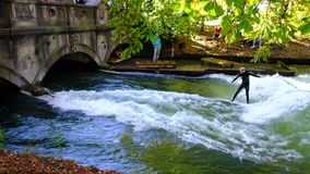 River surfing the Eisbachwelle downtown Munich stock footage