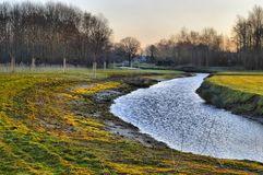 River surrounded by field and trees Stock Photography