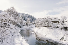 River surrounded with snow at Takayama Stock Photography