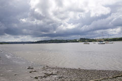 River Tamar near Weir quay. On a cloudy day looking towards Cornwall, with Yachts moored in the river stock image