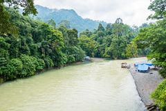 A River in Tangakahan, Indonesia. Tangkahan is a small village on the border of Gunung Leuser National Park in North Sumatra. It is situated at the junction of 2 Royalty Free Stock Photo