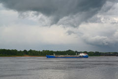 The river tanker floats across Volga in storm weather Stock Photography