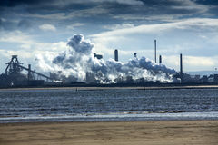 River Tees Estuary. Industrial plant on the estuary of the River Tees, near Hartlepool and Middlesbrough, in Cleveland, England, with steam emissions, viewed Royalty Free Stock Photo