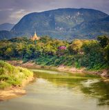 River, temple and mountains. Beautiful landscape. Laos. Royalty Free Stock Photography