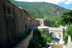 The River Tet runs by the pretty walled town of Villfranche de Conflent. In the south of France. This medieval city dates back to the 11th century Stock Images