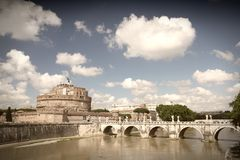 River Tevere in Rome. Rome, Italy. View of famous Castel Sant' Angelo and Sant' Angelo Bridge. River Tevere. Cross processed color tone - retro image filtered Royalty Free Stock Photos