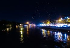 Loi Krathong festival in Chiang Mai Thailand on the river with l. A river in Thailand with lights rising and lights reflecting Royalty Free Stock Photography