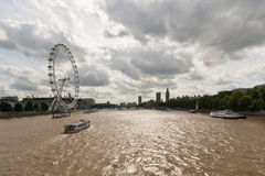 The River Thames. London with views of the London Eye and the Houses of Parliament Royalty Free Stock Photo