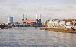 The River Thames at Battersea. The iconic Battersea Power Station and gas tower alongside the River Thames in London as seen from Vauxhall Bridge Stock Images