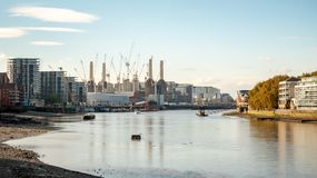 The River Thames and Battersea Power Station. A view along London`s River Thames at low tide illustrating the conversion and development work being carried out royalty free stock photo