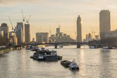 River Thames Boats At Sunset In London, Uk. River Thames Boats Against Skyscraper Buildings At Sunset In London, Uk royalty free stock images