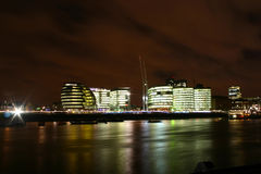 River Thames with buildings. Modern buildings at river Thames, London by night stock images