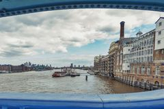 The River Thames and Butler`s Wharf Pier seen from the Tower Bridge of London, England