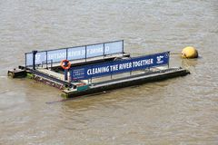River Thames cleaning. LONDON, UK - MAY 13, 2012: River Thames pollution cleaning platform in London. The platforms on River Thames collect garbage, waste and Royalty Free Stock Images