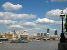 River Thames in London. View towards the City and St Pauls with Blackfriars Bridge, taken in summer Stock Images
