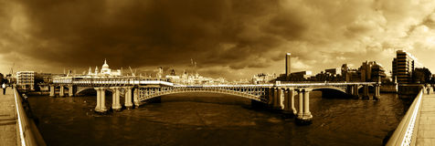 River Thames, London. Panoramic of River Thames, London with storm clouds brewing Royalty Free Stock Photo