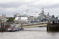 River Thames London UK cruise ship and warship Stock Images