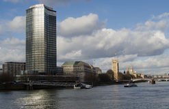 River Thames at Millbank, London. View from Vauxhall across the River Thames towards Millbank and Westminster.  The Houses of Parliament are in sunshine and the Stock Photography