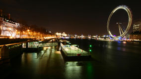 River Thames at Night. Wide-angle night view over the River Thames, London, from Westminster bridge looking East with the London Eye and South Bank Centre to the royalty free stock photo