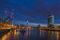 By the river. River Thames at night, and you can see Millbank tower ond the right and in the distance Riverside tower Vauxhaull Stock Photography