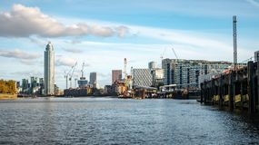 River Thames and Nine Elms, London. A view east of the River Thames from Battersea towards Nine Elms and Vauxhall. Extensive redevelopment work is being carried stock photos