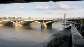 River Thames railway bridge, London. Trains passing over the River Thames near Battersea and Pimlico on their way to and from Victoria train station, a mainline stock video footage