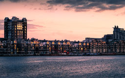 River Thames at sunset at Battersea Riverside, with apartment buildings of Fulham. Stock Photography