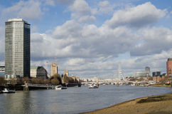 River Thames at Vauxhall. View from the south bank of the River Thames at Vauxhall in Central London.  Millbank Tower and the Houses of Parliament are on the Stock Photo