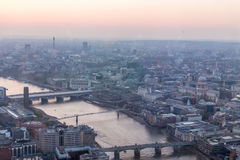 River Thames. A view of Thames river and London at sunset with red sky and air pollution Stock Photography