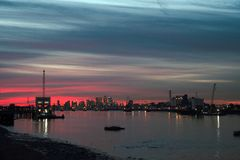 River Thames, Woolwich. A stretch of the River Thames near Woolwich, Woolwich Pier, Woolwich Ferry and the Thames Flood Barrier royalty free stock image